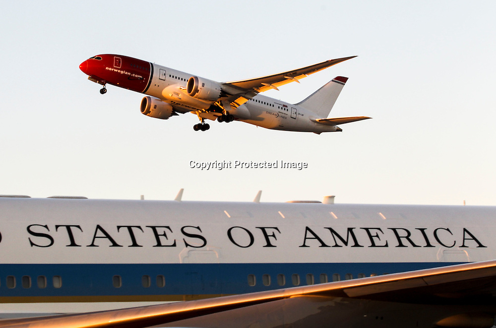 A Norwegian Airlines‎ aircraft flies past Air Force One sitting on the tarmac after landing at Los Angeles International Airport in Los Angeles on Saturday, Oct. 10, 2015.  (AP Photo/Ringo H.W. Chiu)