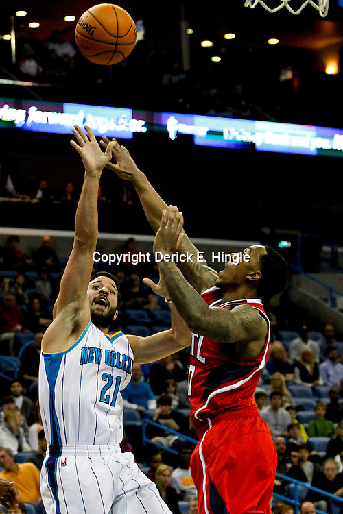 Jan 1, 2013; New Orleans, LA, USA; New Orleans Hornets point guard Greivis Vasquez (21) shoots over Atlanta Hawks point guard Jeff Teague (0) during the first quarter of a game at the New Orleans Arena. Mandatory Credit: Derick E. Hingle-USA TODAY Sports