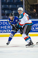 KELOWNA, CANADA - AUGUST 31:  Jack Cowell #8 of the Kelowna Rockets checks Phillip Schultz #27 of the Victoria Royals after the face off on August 31, 2018 at Prospera Place in Kelowna, British Columbia, Canada.  (Photo by Marissa Baecker/Shoot the Breeze)  *** Local Caption ***