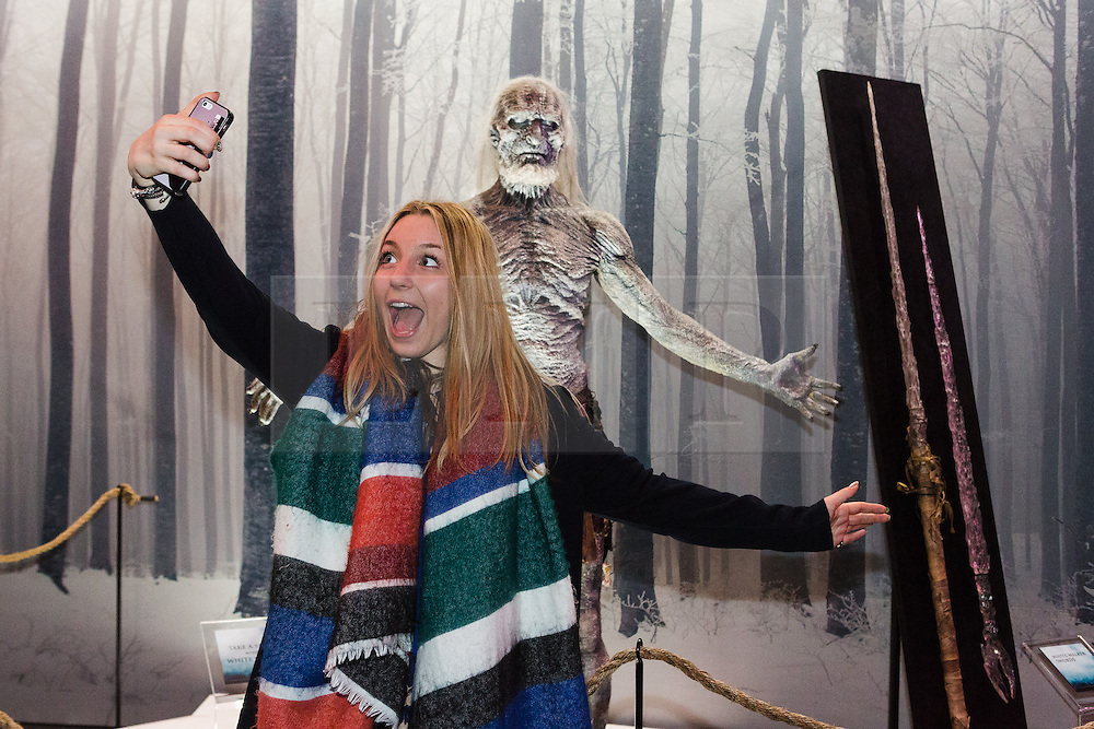 © Licensed to London News Pictures. 09/02/2015. London, UK. A visitor to the Game of Thrones exhibition takes a selfie with an exhibit on 9th February 2014 at the O2 Arena in Greenwich, south-east London. Photo credit : Vickie Flores/LNP