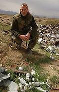 Norwegian De-mining officer in bomb and mine-strewn field.