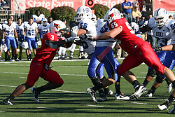 22 October 2011: Eric Brunner closes the gap on Ronnie Fouch as Justin Wood keeps Evan Frierson out of the action during an NCAA football game  the Indiana State Sycamores lost to the Illinois State Redbirds (ISU) 17-14 at Hancock Stadium in Normal Illinois.