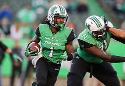 Nov 25, 2017; Huntington, WV, USA; Marshall Thundering Herd wide receiver Willie Johnson (1) runs the ball during the third quarter against the Southern Miss Golden Eagles at Joan C. Edwards Stadium. Mandatory Credit: Ben Queen-USA TODAY Sports