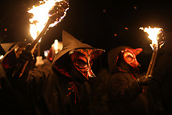 © Licensed to London News Pictures. 06/02/2016. Marsden, UK. Hooded men and women wearing fox masks carry flaming torches during the spectacular Imbolc fire festival in Marsden, West Yorkshire, UK. Based on ancient pagan traditions,  Imbolc is a Gaelic festival celebrating the end of winter and the coming of spring. The focal point of the event is the face-off between the Green Man, who represents the coming spring, and Jack Frost, winter - with the former coming out on top. Photo credit : Ian Hinchliffe/LNP