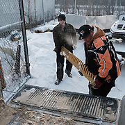 Chad Henry (right) collecting a set of ice blades for a grader from Neniska Repairs near Kenora, Ontario, Canada on 14 December 2016. A member of the Ochiichagwe'Babigo'Ining Ojibway Nation (also known as the Dalles First Nation) located approximately 20km from Kenora, Henry is responsible for operations and maintenance tasks on the Nation's reserve. In 2013, together with a council of the community's youth, he initiated a project to erect a tower to bring broadband Internet access to the reserve.