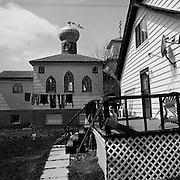 An abandoned Russian Orthodox Church seen from a backyard in Kirkland Lake, Ontario. From the book Cage Call: Life and Death in the Hard Rock Mining Belt. An in-depth project spanning over 12-years examining communities in one of the richest mining regions in the world located in Northwestern Ontario and Northeastern Quebec in Canada.
