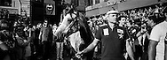 The Nincchio horse arrives in Piazza del Campo for the race followed by the people from the contrada