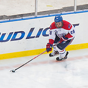 Jake Suter #28 of the UMass Lowell Riverhawks in action during the Frozen Fenway game between The Northeastern Huskies and The UMass Lowell Riverhawks at Fenway Park on January 11, 2014 in Boston, Massachusetts.