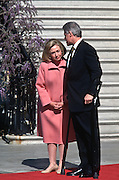 President Bill Clinton on crutches with wife Hillary during the arrival ceremony for visiting Canadian Prime Minister Jean Chrétien April 8, 1997 on the South Lawn of the White House.