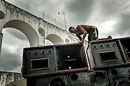 """Preparation - assembling a soundsystem for the """"Rio Parada Funk"""" giant yearly party, for once in the traditional district of Lapa, Center of Rio de Janeiro."""