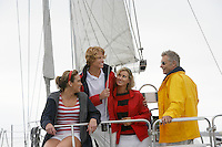 Four people on sailboat in sea
