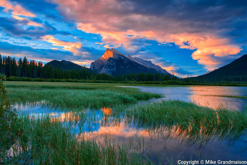 Clouds and Mt. Rundle  reflected in Vermillion Lakes at sunrise<br />Banff National Park<br />Alberta<br />Canada