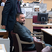 AUGUST 13, 2018---FORT LAUDERDALE, FLORIDA--<br /> Pablo Ibar looks at his wife and family as he sits in a courtroom in the Broward County Courthouse at the beginning of a hearing to schedule his new trial. Ibar has been in jail  for 24 years accused of the murders of a bar owner and two models in his house following a home invasion.<br /> (Photo by Angel Valentin)