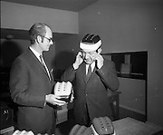 21/04/1970<br /> 04/21/1970<br /> 21 April 1970<br /> A new safety helmet for use by hurling players was shown publicly for the first time at Croke Park on the 21st of April 1970. The helmet was the first of its kind to be designed and manufactured completely in Ireland. The helmet was manufactured by William Cox (Ireland) LTD. The director and general manager, Mr. Jim Shannon presented some sample helmets to Seán Ó Síocháin, General Secretary of the G.A.A. The helmets were available in county or club colours.<br /> <br /> In the picture: Seán Ó Síocháin (right) tries out one of the new helmets with Mr. Jim Shannon casting an expert eye over the operation.
