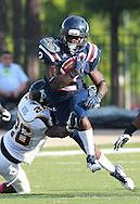 Samford running back Fabian Truss  (2) gets hit by  Appalachian State defensive back Joel Ross (26)in the first half at Seibert Stadium in Homewood, Ala., Saturday, Oct 13, 2012. (Marvin Gentry)