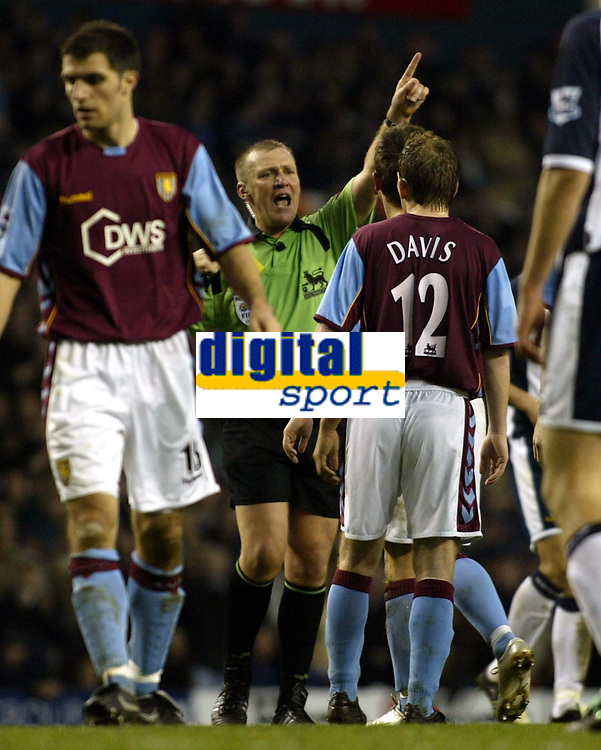 Photo: Chris Ratcliffe.<br />Tottenham Hotspur v Aston Villa. The Barclays Premiership. 21/01/2006.<br />Graham Poll (C) the referee sends off Gareth Barry, not in picture.