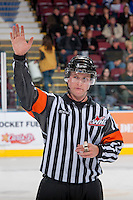 KELOWNA, CANADA - OCTOBER 4:  Brett Iverson, referee, stands on the ice  at the Kelowna Rockets on October 4, 2013 at Prospera Place in Kelowna, British Columbia, Canada (Photo by Marissa Baecker/Shoot the Breeze) *** Local Caption ***