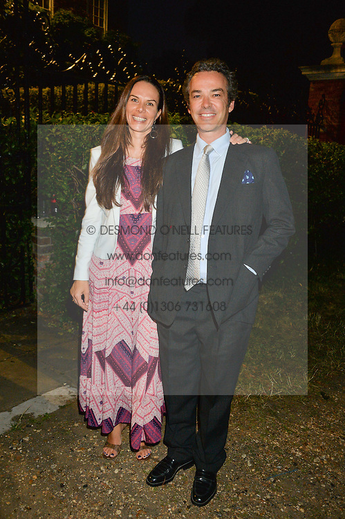 HENRY & LILI DENT-BROCKLEHURST attending Annabel Goldsmith's Summer party held at her home in Ham, Surrey on 10th July 2014.