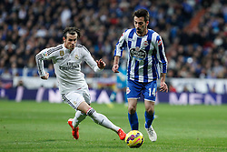 14.02.2015, Estadio Santiago Bernabeu, Madrid, ESP, Primera Division, Real Madrid vs Deportivo La Coruna, 23. Runde, im Bild Real Madrid&acute;s Gareth Bale (L) and Deportivo de la Courna&acute;s Isaac Cuenca // during the Spanish Primera Division 23rd round match between Real Madrid vs Deportivo La Coruna at the Estadio Santiago Bernabeu in Madrid, Spain on 2015/02/14. EXPA Pictures &copy; 2015, PhotoCredit: EXPA/ Alterphotos/ Victor Blanco<br /> <br /> *****ATTENTION - OUT of ESP, SUI*****