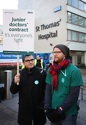 © Licensed to London News Pictures. 12/01/2016. London, UK. Junior doctors stand on a picket line outside St Thomas' Hospital.  Doctors are holding a one day strike over proposed new working hours - the first strike in 40 years. Photo credit: Peter Macdiarmid/LNP