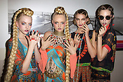 Models prepare for Romance Was Born catwalk show during their spring/summer launch at the State Library of NSW, Sydney. Sally Hansen nail designs were featured on all the models..