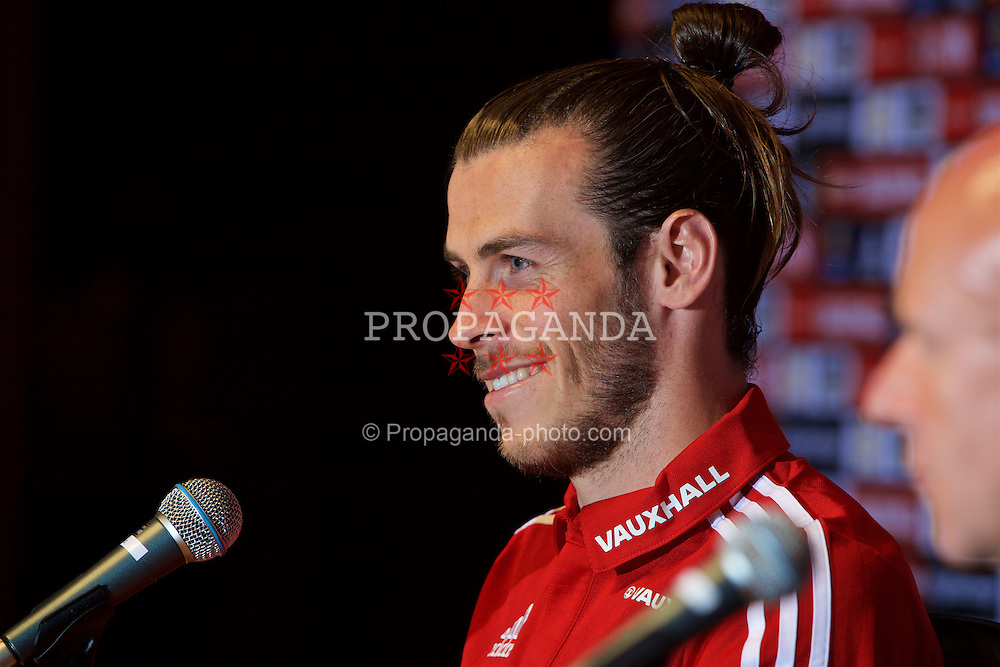 DINARD, FRANCE - Wednesday, June 29, 2016: Wales' Gareth Bale during a press conference at their base in Dinard as they prepare for the Quarter-Final match against Belgium during the UEFA Euro 2016 Championship. (Pic by David Rawcliffe/Propaganda)