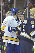 Lake Superior State's Zac MacVoy (27) responds to a verbal challenge from Notre Dame defenders after a scuffle in front of the Irish net during Saturday's game in Sault Ste. Marie.