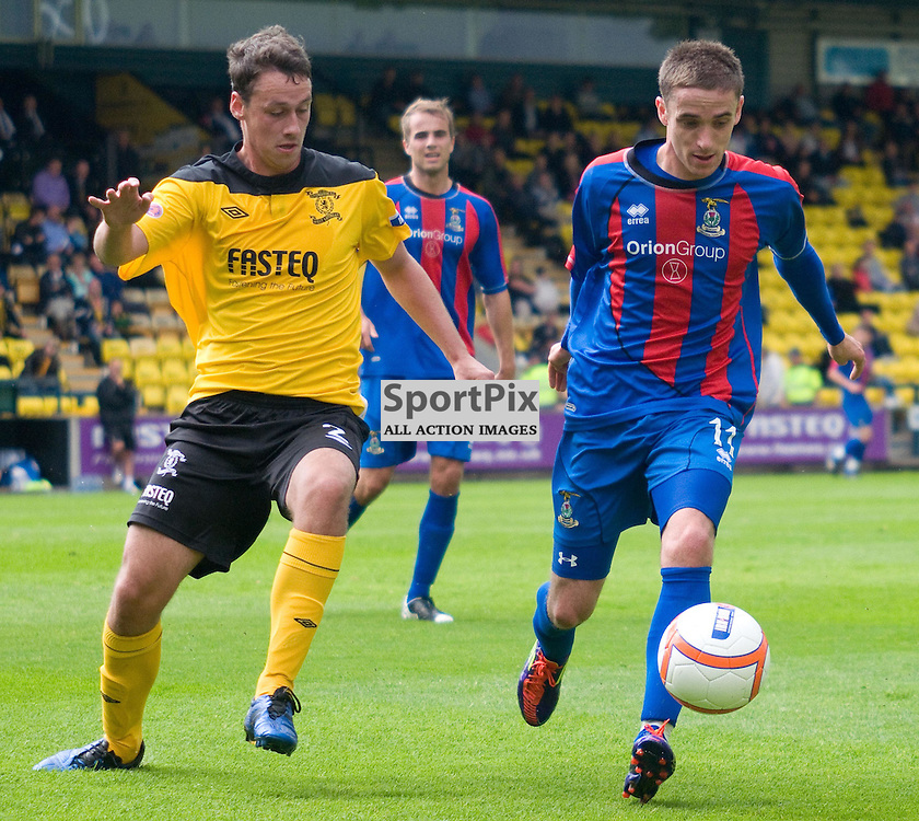 Nick Ross gets to the ball before Johnny Brown , Livingston v Inverness