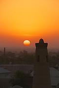 Uzbekistan, Khiva. A minaret at sunset.