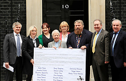 © Licensed to London News Pictures 24/04/2013.Actors Brian Blessed and Annette Crosbie join MPs and NAVS (National Anti-Vivisection Society), in delivering a petition, calling for less secrecy in animal laboratories, on World Day for Laboratory Animals. From left, Tim Phillips, NAVS campaign director, Tessa Munt MP, Kerry McCarthy MP, Annette Crosbie, Jan Creamer, CEO of NAVS, Brian Blessed, Adrian Sanders MP and Jim Dowd MP..London, UK.Photo credit: Anna Branthwaite/LNP