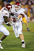 Arkansas Razorback quarterback Alex Mortensen hands the ball off during a 70 to 17 loss to the University of Southern California Trojans on September 17, 2005 at the Los Angeles Memorial Coliseum in Los Angeles, California..Mandatory Credit: Wesley Hitt/Icon SMI