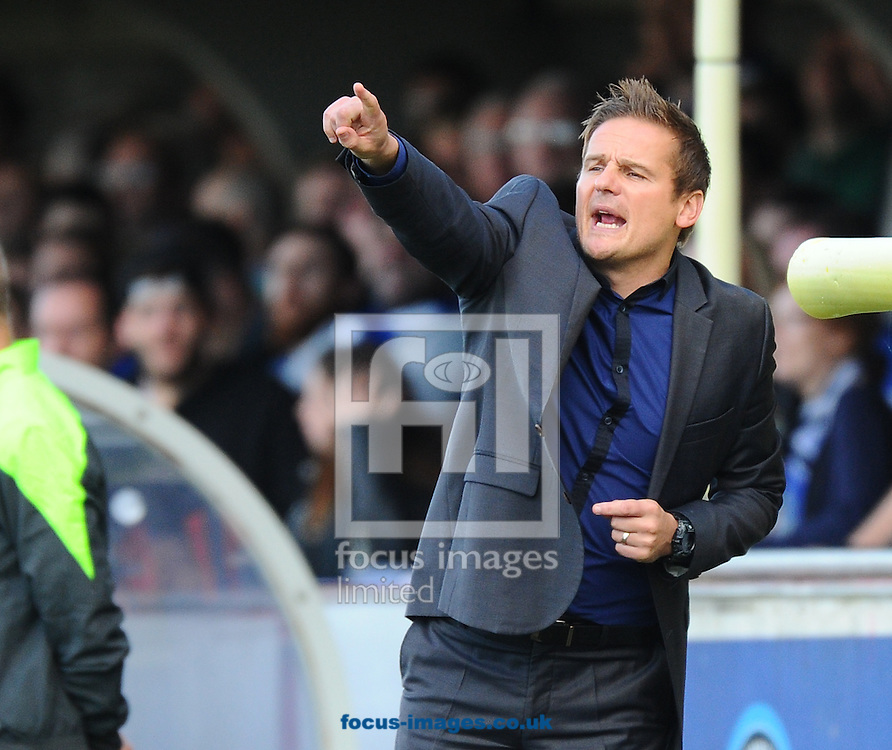 Manager of AFC Wimbledon Neal Ardley gives out instructions to his players during the Sky Bet League 2 match at the Cherry Red Records Stadium, Kingston<br /> Picture by Seb Daly/Focus Images Ltd +447738 614630<br /> 11/10/2014