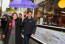 © Licensed to London News Pictures. 09/11/2013 London, UK. Labour Party leader Ed Miliband walks through Crouch End with Labour prospective parliamentary candidate for Hornsey and Wood Green, Catherine West during a visit to the constituency.<br /> Photo credit : Simon Jacobs/LNP