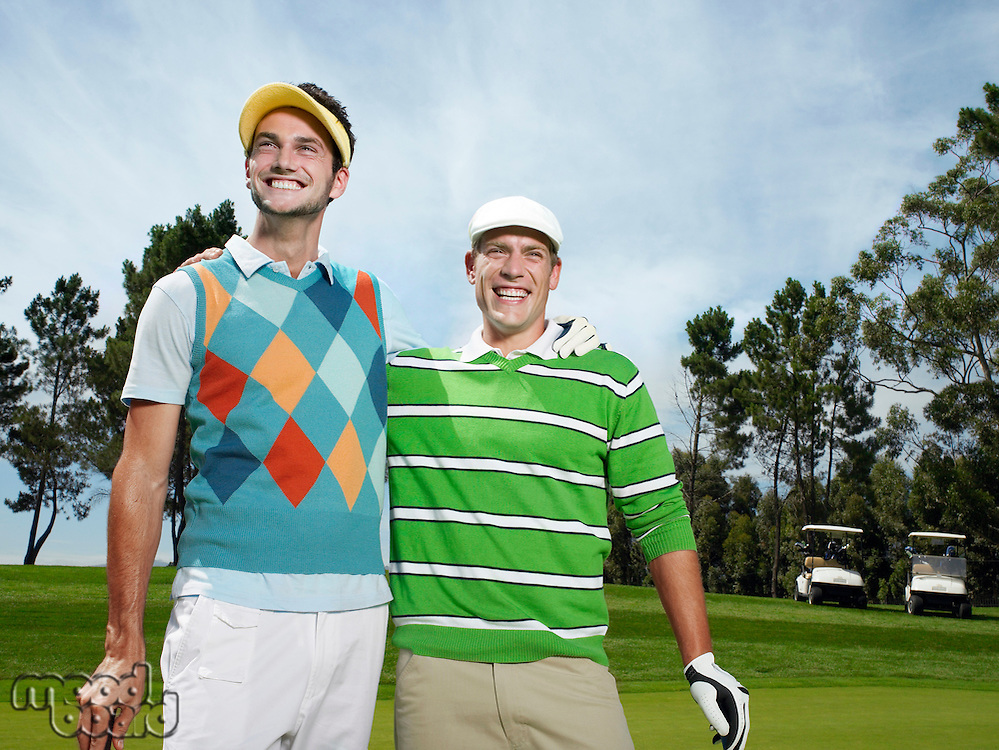 Two young male golfers on green