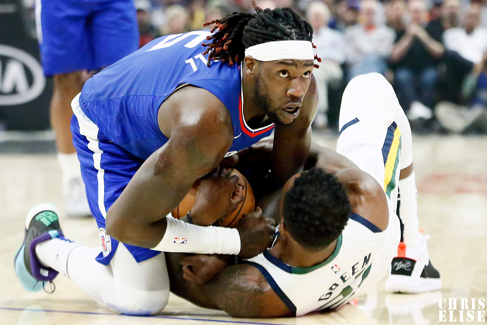 LOS ANGELES, CA - NOV 3: Montrezl Harrell (5) of the LA Clippers fights for the ball with Jeff Green (22) of the Utah Jazz during a game on November 3, 2019 at the Staples Center, in Los Angeles, California.