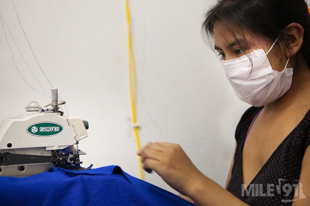A Bolivian lady working in a immigrant sewing workshop in, São Paulo. Nearly 90% of the immigrants arriving in São Paulo end up working in the textile industry. Today there are about 20,000 sewing shops in São Paulo and 400,000 immigrants working in the clothing sector.