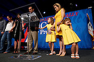 Catherine Cruz, 4 (right), leans against mother Heidi Cruz as Republican Ted Cruz says a closing prayer alongside his other daughter Caroline, 7, Friday, Aug. 21, 2015, at the Rally for Religious Liberty in Des Moines.