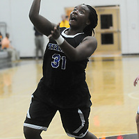 Trask's Saniyyah Mccallister shoots against Topsail Friday December 5, 2014 at Topsail High School in Hampstead, N.C. (Jason A. Frizzelle)
