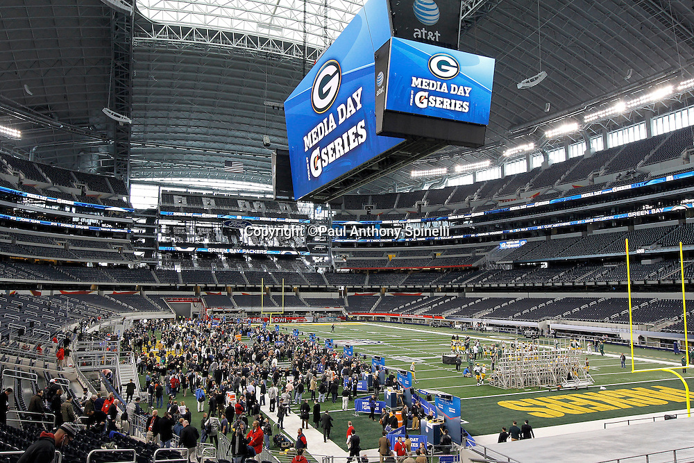 General view of the inside of Cowboys Stadium and its overhead, high definition television screens while a huge crowd of media get set to interview members of the NFC Green Bay Packers at Super Bowl XLV media day prior to NFL Super Bowl XLV against the Pittsburgh Steelers. Media day was held on Tuesday, February 1, 2011 in Arlington, Texas. ©Paul Anthony Spinelli