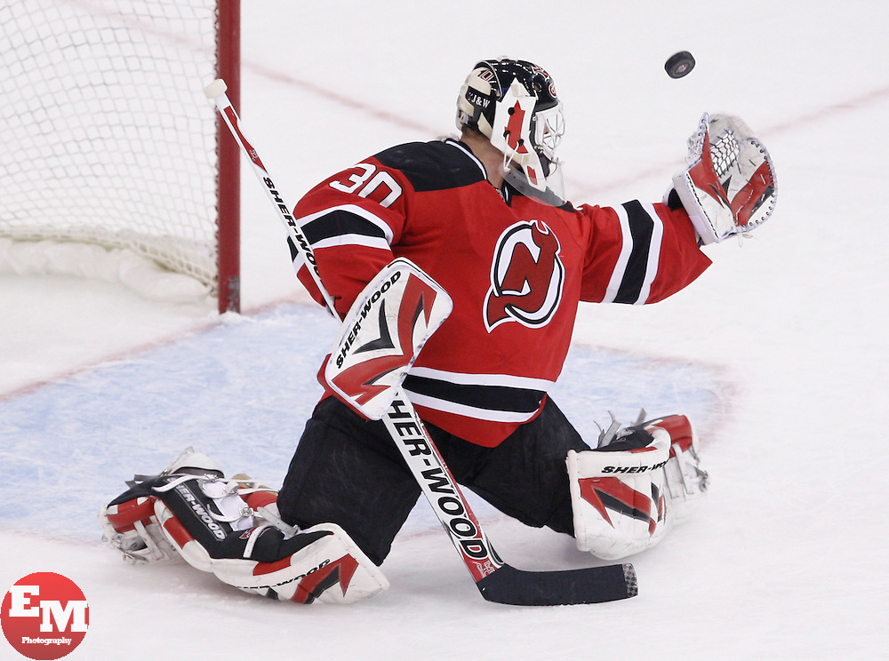 Oct 5, 2009; Newark, NJ, USA; New Jersey Devils goalie Martin Brodeur (30) makes a glove save during the second period at the Prudential Center.