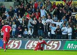 SWANSEA, ENGLAND - Friday, September 4, 2009: Wales' Aaron Ramseycelebrates scoring the winning goal againstItaly in front of his own fans during the UEFA Under 21 Championship Qualifying Group 3 match at the Liberty Stadium. (Photo by Gareth Davies/Propaganda)