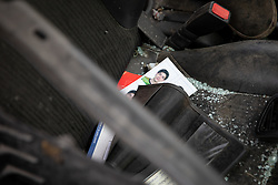 © Licensed to London News Pictures. 10/08/2020. Beirut, Lebanon.  ID photos are seen amongst smashed glass in an abandoned, wrecked car, in Beirut port, as part of the aftermath around Beirut following an explosion in Beirut port on Tuesday 4 August. Photo credit : Tom Nicholson/LNP