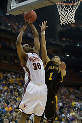 Virginia Cavaliers forward Adrian Joseph (30) shoots over Albany Great Danes guard/forward Jason Siggers (1).  The #4 seed Virginia Cavaliers defeated the #13 seed Albany Great Danes 84-57 in the first round of the South Region Men's NCAA Tournament in Columbus, OH on March 16, 2007.