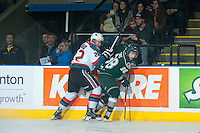 KELOWNA, CANADA - JANUARY 24: Chance Braid #22 of Kelowna Rockets checks Kevin Davis #38 of Everett Silvertips on January 24, 2015 at Prospera Place in Kelowna, British Columbia, Canada.  (Photo by Marissa Baecker/Shoot the Breeze)  *** Local Caption *** Chance Braid; Kevin Davis;