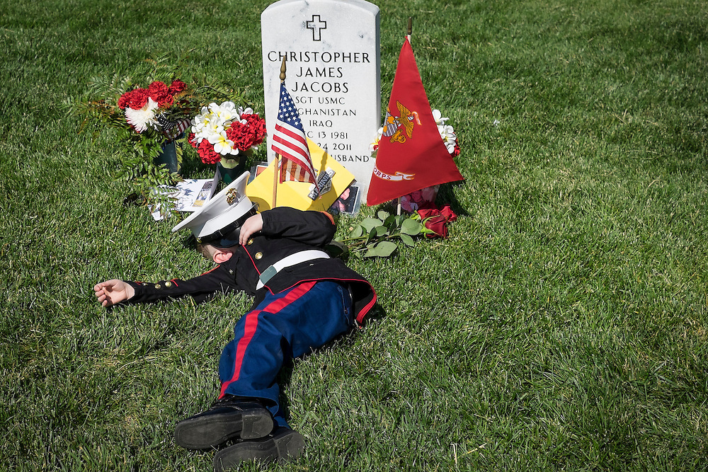On Memorial Day, Christian Jacobs, 4, of Hertford, North Carolina lays down next to the headstone of his father, Marine Sgt. Christopher Jacobs, in Section 60 at Arlington National Cemetery in Arlington, Virginia, USA, on 25 May 2015.