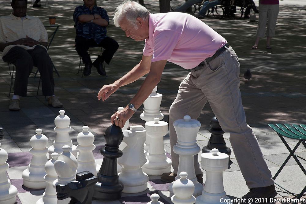 Making a move giant chess game, West Lake Plaza, Seattle, Washington, USA
