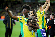Norwich City midfielder Alexander Tettey (27)  celebrates promotion to the Premier League after the EFL Sky Bet Championship match between Norwich City and Blackburn Rovers at Carrow Road, Norwich, England on 27 April 2019.
