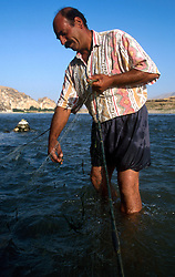 TURKEY HASANKEYF JUL02 - Fisherman Mehmet Hakim checks his net spread overnight in the Tigris river for any catch. Since the programme of barrages has commenced on the Tigris, his daily yield has been reduced to a few fish...jre/Photo by Jiri Rezac..© Jiri Rezac 2002..Contact: +44 (0) 7050 110 417.Mobile:  +44 (0) 7801 337 683.Office:  +44 (0) 20 8968 9635..Email:   jiri@jirirezac.com.Web:     www.jirirezac.com