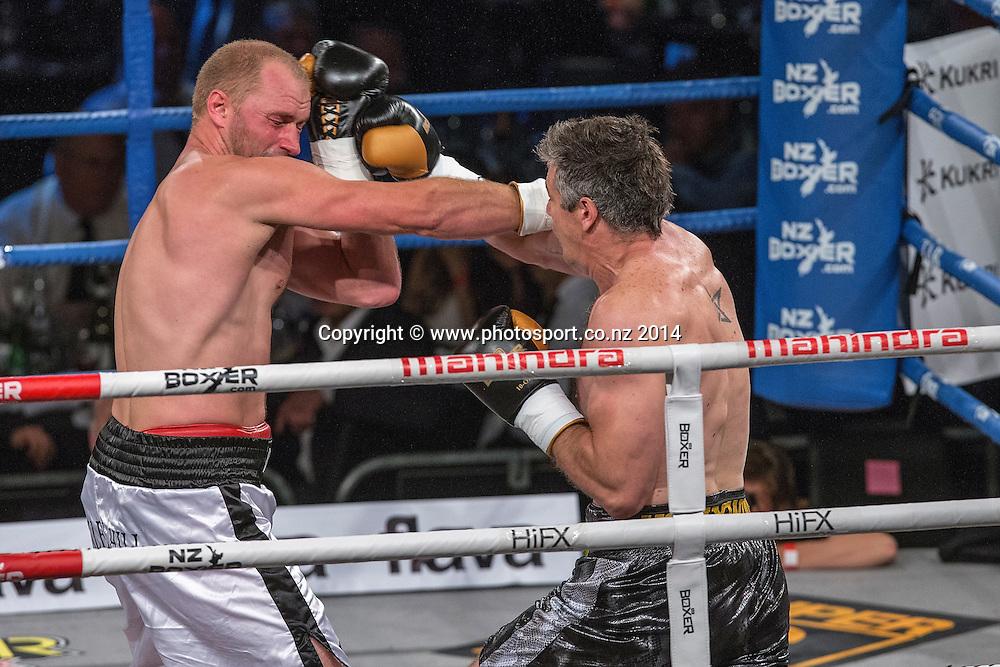 Daniel Ammann (L) fights Brad `Hollywood` Pitt in the Mahindra Super 8 Fight Night, North Shore Events Centre, Auckland, New Zealand, Saturday, November 22, 2014. Photo: David Rowland/Photosport
