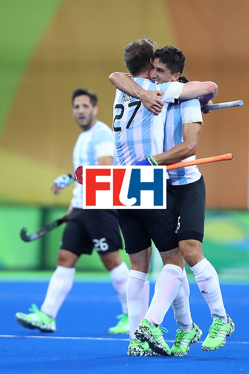 RIO DE JANEIRO, BRAZIL - AUGUST 18:  Ignacio Ortiz #16 of Argentina celebrates scoring a goal during the Men's Hockey Gold Medal match between Belgium and Argentina on Day 13 of the Rio 2016 Olympic Games at Olympic Hockey Centre on August 18, 2016 in Rio de Janeiro, Brazil.  (Photo by Clive Brunskill/Getty Images)